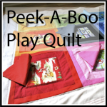 play quilt button