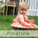 pinafore baby button