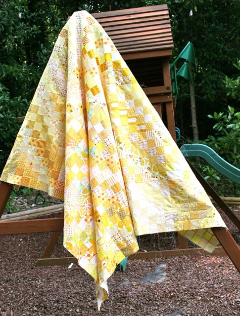 all yellow scrappy quilt top