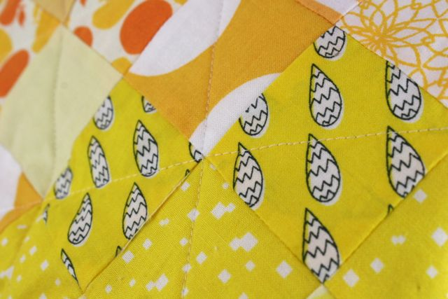 lattice quilting on all-yellow scrappy quilt