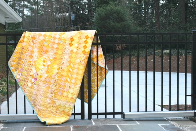 yellow scrappy quilt