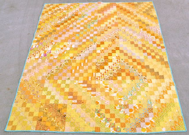 yellow scrappy trips around the world quilt | whipstitch
