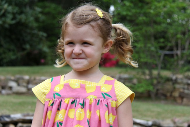 Small World corduroy makes little girls smile | Lemon Drop Pinafore by Whipstitch