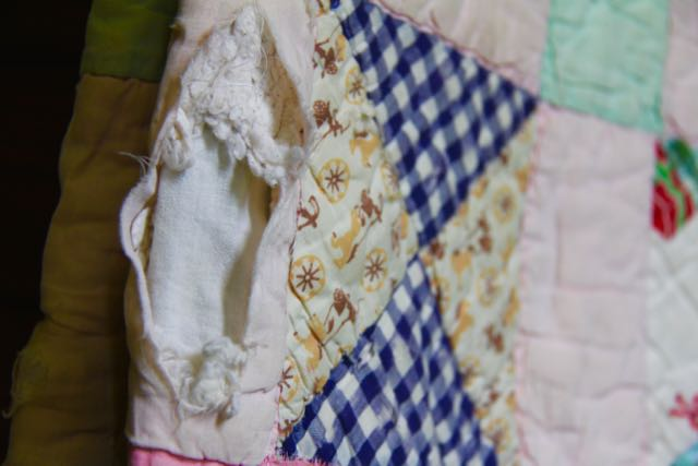 scrappy damaged vintage quilt